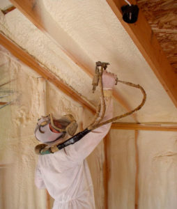 spraying insulation in Russell Crossing home